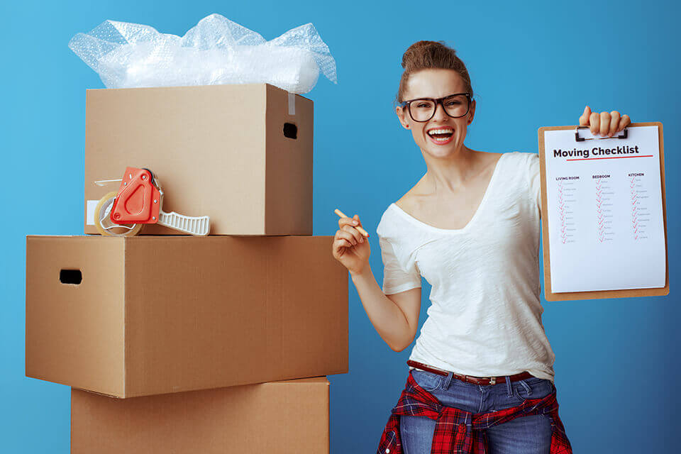 Woman with boxes and a checklist