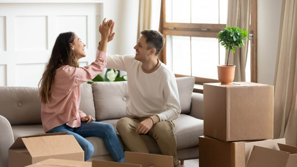 Couple at new home after relocation