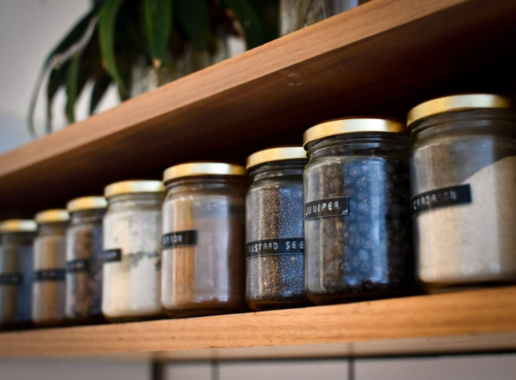 jars with spices on a shelve