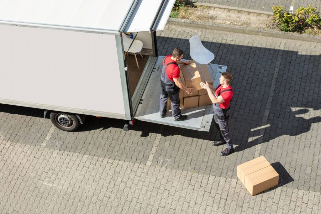 Professional movers putting things in a truck