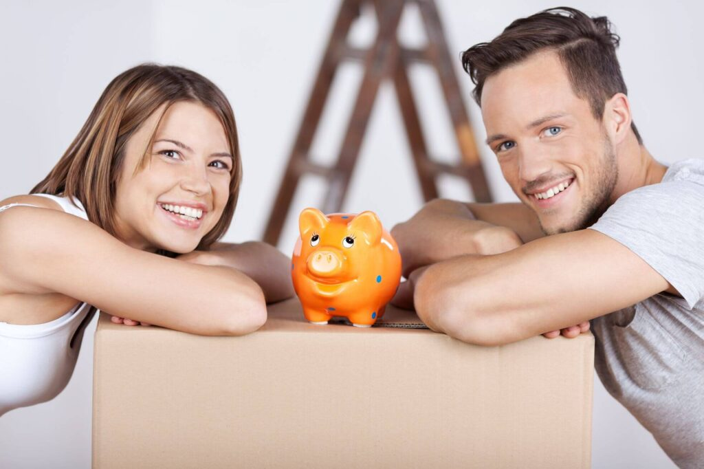 Happy couple with a piggy bank