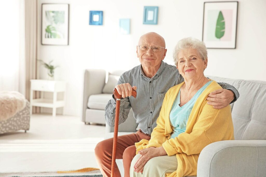 Happy elderly couple sitting on a couch
