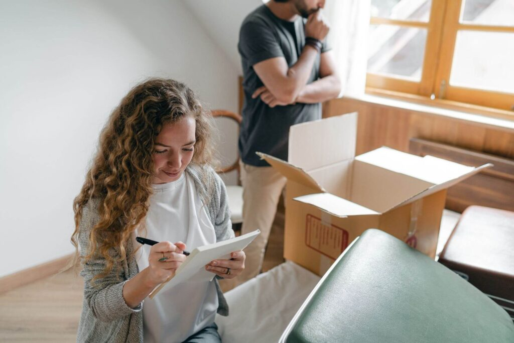 A woman going through the contract she signed with professional movers in Philadelphia, PA