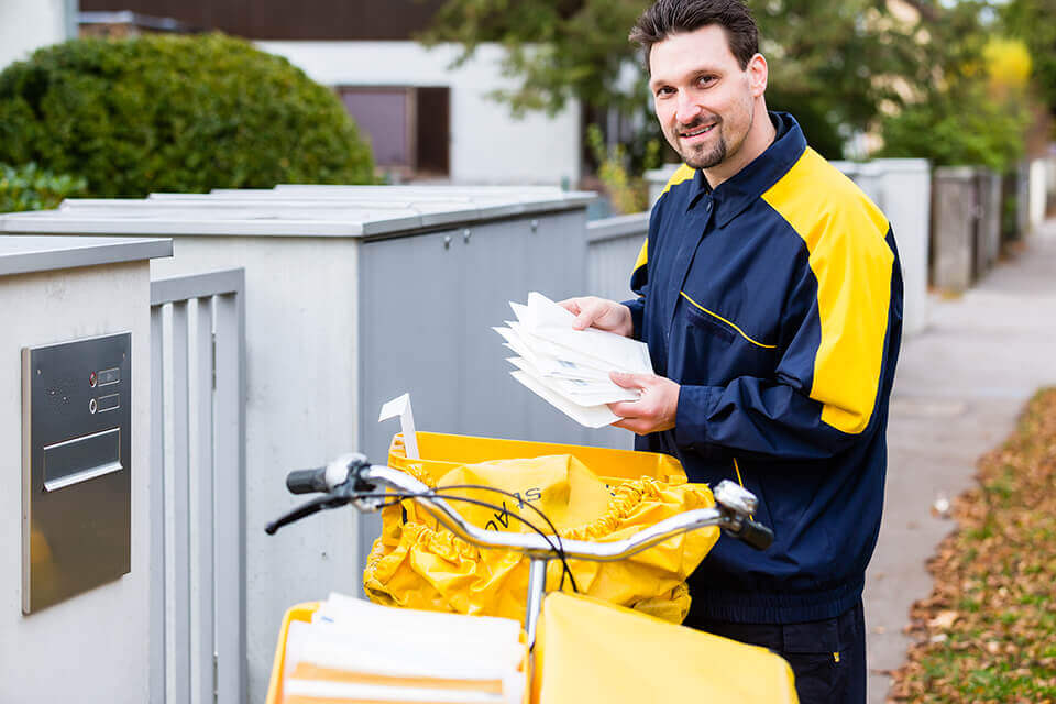 A postal carrier deploying receipts from several Philadelphia moving companies