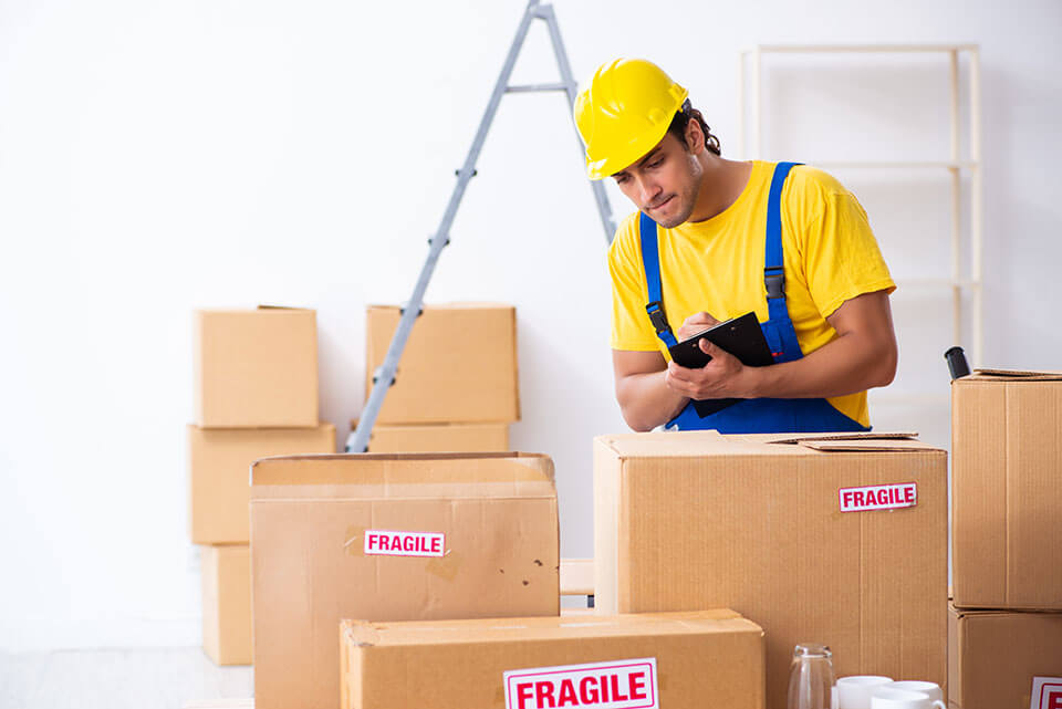 A man working for one of the local Philadelphia moving companies inspecting boxes