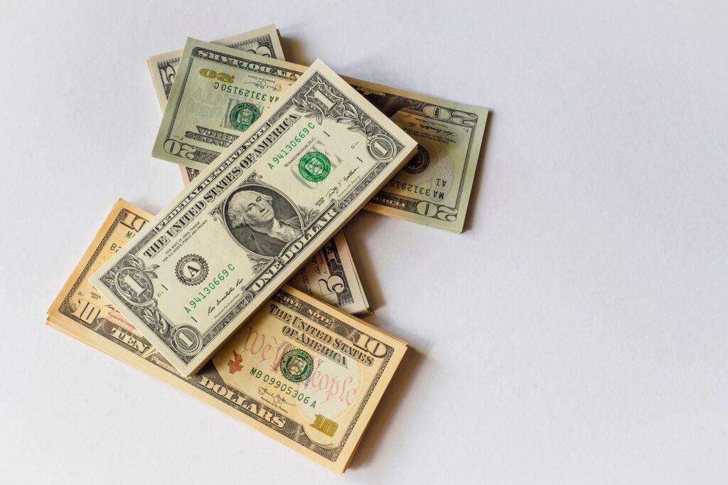Dollar bills on a white surface