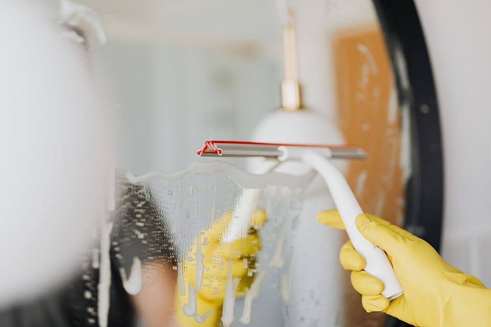 A person polishing a window