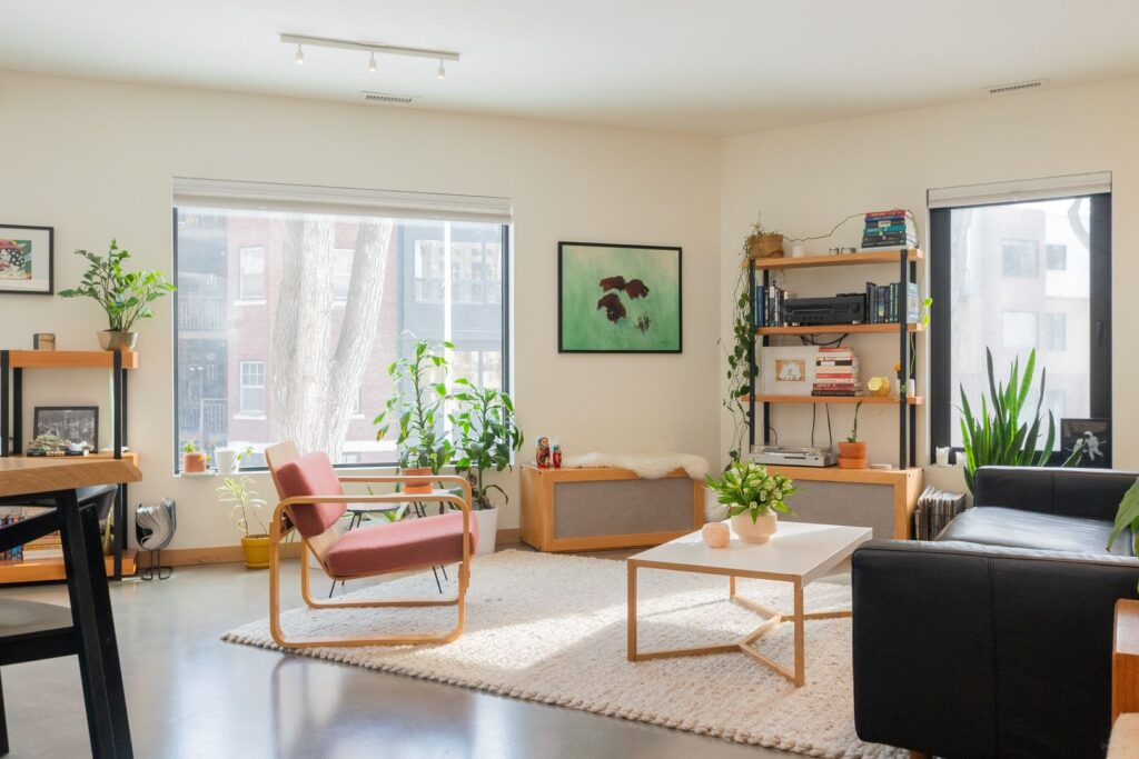 A couch, chair, and shelves in the living room