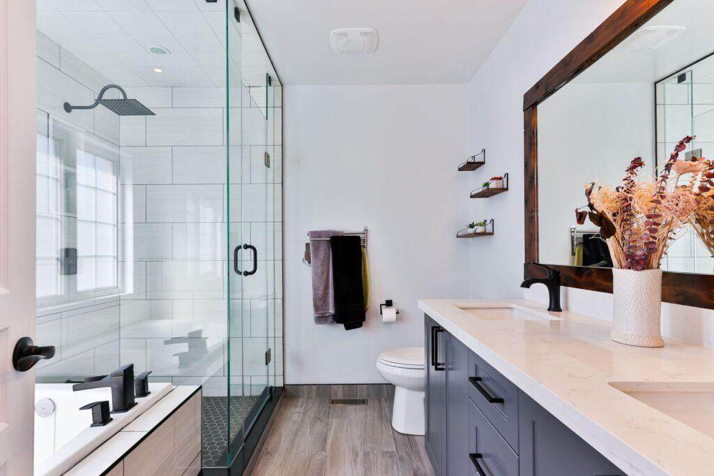 Bathroom with white ceramic sink, shower, bathtub, and toilet