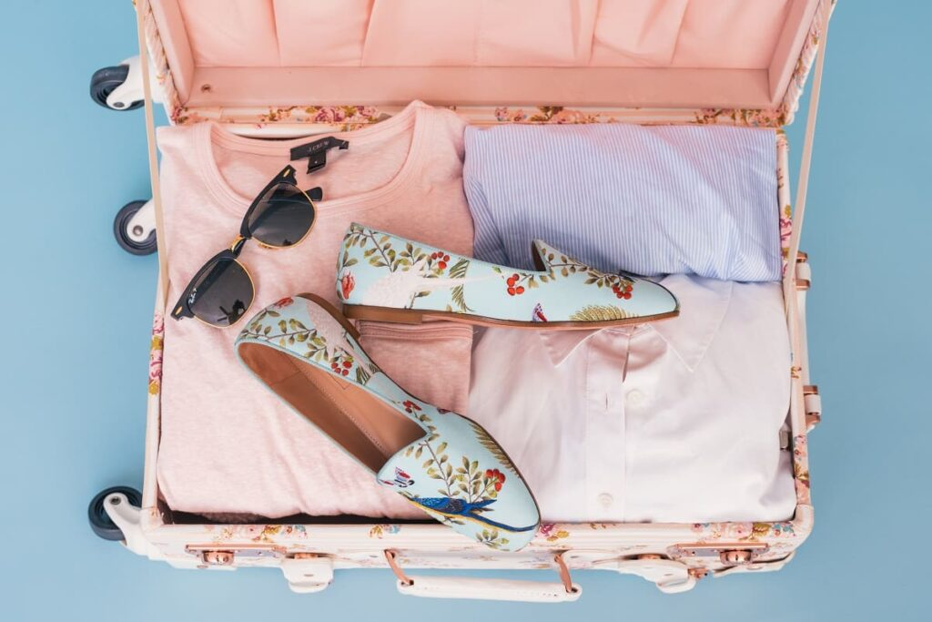 A packed suitcase with shoes instead of a box