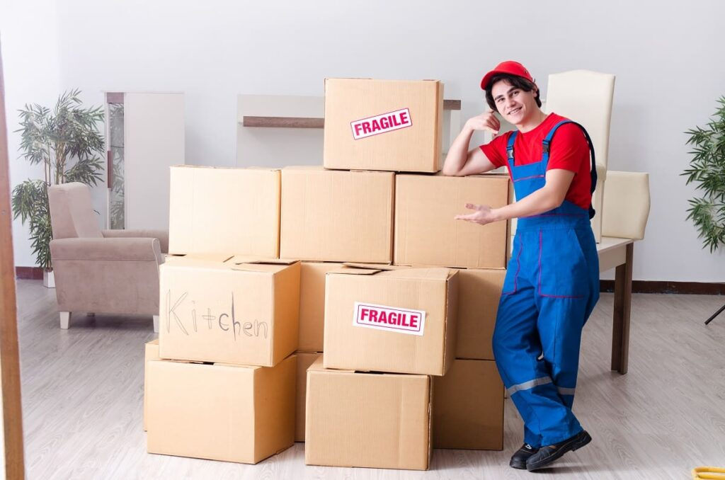 Professional working for moving services in Philadelphia with his packed containers