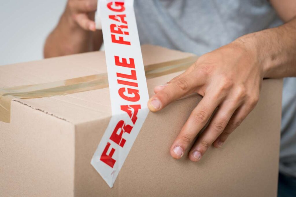 One of the Philly movers placing a label on a box